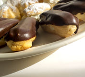 Cakes - cream puffs and eclairs Stock Photos