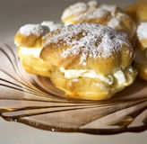 Cakes - cream puffs and eclairs Royalty Free Stock Photography