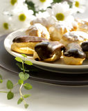 Cakes - cream puffs and eclairs Royalty Free Stock Photo