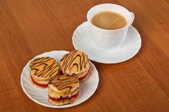 Cakes and cup of coffee. Royalty Free Stock Image