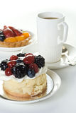 Cakes and cup of coffee. Coffee cup with fruit on white Stock Photo