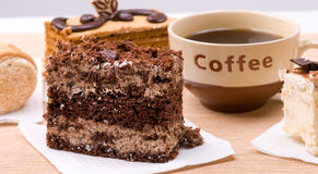Cakes with cup of coffee Royalty Free Stock Images