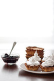 Cakes with currants and cream Royalty Free Stock Image