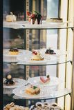 Cakes and desserts in a shop window Stock Image