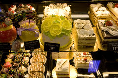 Cakes and desserts in supermarket stock images