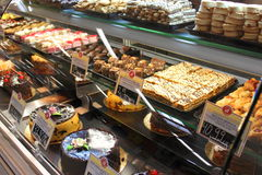 Cakes and desserts in supermarket. Many kinds of yummy and beautiful cakes and desserts in market Stock Photo