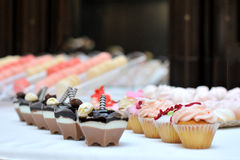 Cakes. Different cakes arranged for reception Royalty Free Stock Image