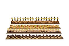 Cakes of different sorts with nuts, fruits, nougat and chocolate. Cakes of different sorts with nuts, fruits, nougat and chocolate isolated on white background royalty free stock photography
