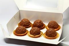 Cakes in doos Stock Foto