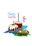 Cakes and Easter eggs in the basket. The feast on the table there are cakes and Easter eggs in the basket Royalty Free Stock Photo