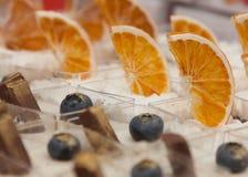Cakes embellished with orange and chocolate. Cakes decorated with blueberries, orange and chocolate Royalty Free Stock Image