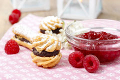 Cakes filled with raspberry jam Stock Photos