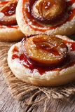 Cakes of flaky pastry with plums close up vertical Royalty Free Stock Photos