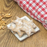 Cakes in form of stars laying on white ceramic plate Royalty Free Stock Photos