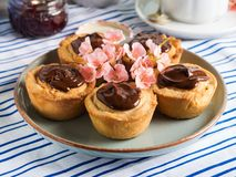 Cakes with frangipane, cherry jam and chocolate Royalty Free Stock Photography
