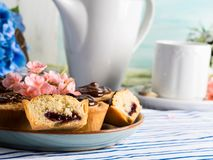 Cakes with frangipane, cherry jam and chocolate Stock Photography