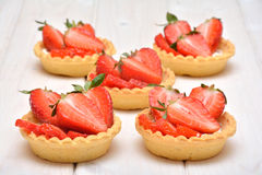 Cakes with fresh strawberries Royalty Free Stock Photo