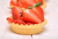 Cakes with fresh strawberries Stock Images