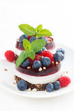 Cakes with fruit jelly and fresh berries Royalty Free Stock Photo