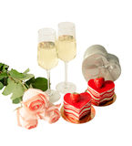 Cakes, glasses of champagne, pink roses  and  gift box Stock Photos