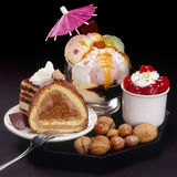 Cakes and ice-cream. Chocolate cakes and ice-cream on a decorated plate stock photos