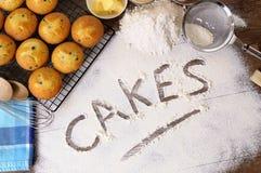 Making cake, ingredients, word written in flour Royalty Free Stock Image