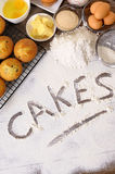 Making cakes with ingredients, word written in flour, vertical Royalty Free Stock Photo