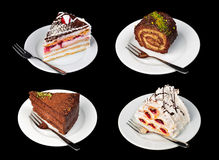 Cakes isolated on black Stock Photo