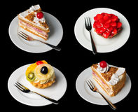 Cakes Isolated On Black Stock Images