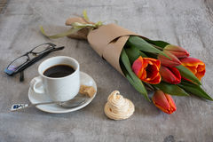 Cakes of meringue with a bouquet of tulips Royalty Free Stock Photos
