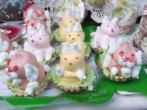 Cakes - meringue. Meringue cake in the form of animals in the basket,confections Royalty Free Stock Photo