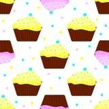 Cakes met roze en geel suikerglazuur Stock Foto