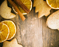 Cakes and orange tastefully arranged on wooden table. Royalty Free Stock Photos