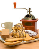 Cakes, pastries, coffee cup and coffee grinder Royalty Free Stock Photography