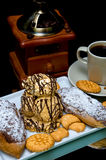 Cakes, pastries and a cup of coffee on a black background closeu Royalty Free Stock Image