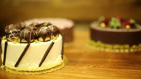 Cakes in the pastry shop. handmade cakes white black patisserie on the table hd