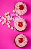 Cakes on pink b Royalty Free Stock Photos