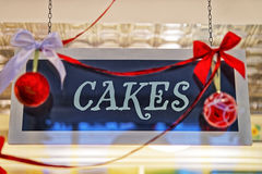 Cakes plate with christmas decorations and red balls. And reflections stock image