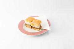 Cakes with napkin on plate Stock Photos