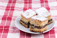 Cakes with poppy seed on the red and white tablecloth Stock Photography