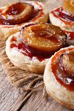 Cakes of puff pastry with plums macro vertical Stock Photo