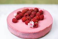 Cakes with raspberries and whipped cream on the plate.  Royalty Free Stock Photo