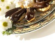 Cakes - roomrookwolken en eclairs Royalty-vrije Stock Afbeeldingen