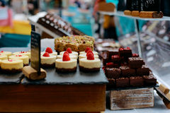 Cakes on sale. Homemade desserts on sale in Greenwich Market, London`s only market set within a World Heritage Site royalty free stock images