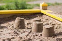 Cakes in the sandbox, close-up. Sand cakes close-up in the sandbox Royalty Free Stock Image