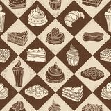 Cakes seamless pattern. On a checkered background Stock Photos