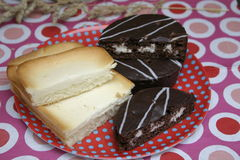 Cakes. Some chocolate and cheese cake on a plate Stock Images