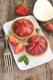 Cakes with strawberries Stock Images