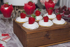 Cakes with strawberries and cream on the wedding table. Dessert royalty free stock photos