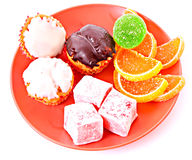Cakes and sweets. Selection of sweets and cakes on plate, isolated on white background stock photography